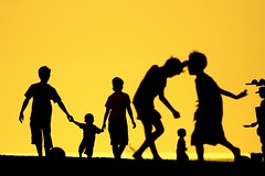 Tibubeneng (Farl) Tags: travel family bali colors silhouette yellow children indonesia gold afternoon shadows action presunset canggu tibubeneng banyupinaruh