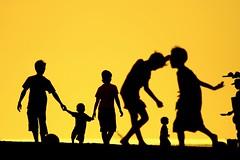Tibubeneng (Farl) Tags: travel family bali colors silhouette yellow children indonesia gold afternoon shadows action presunset canggu tibubeneng banyupinaruh