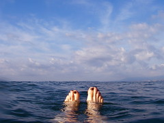 Mediterranean ((ariel)) Tags: blue sea vacation sky feet me water clouds swimming spain toes mediterranean floating optio wetfeet pentaxoptiowpi
