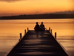 Sitting at the dock of the bay...... (pominoz) Tags: sunset orange lake silhouette newcastle pier big grandmother nsw hunter momma lakemacquarie bigmomma warnersbay picturecollection piratetreasure thatsclassy photofaceoffwinner piratetreasure2 pfogold goldstaraward mozziesarestillbitingthehelloutofme thedailypost motmjan09 motmmar09