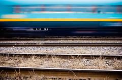 in motion (Ashenzil) Tags: railroad blue motion blur yellow speed train wagon movement weed ribbons aqua track metro stripes stripe rail foin sideway swipe nfv