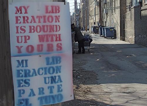 stencil graffiti: my liberation is bound up with yours / mi liberacion es una parte le tuyo