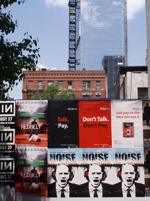 movie ads on temporary wall, Manhattan, NYC