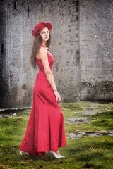 looking back (BarryKelly) Tags: lady red head dress grass castle satin gown galway shoe white heel pose peir