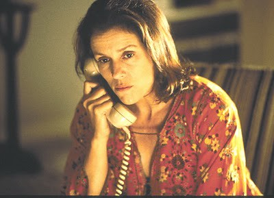 this is a photo of Frances McDormond as Elaine Miller, shown talking on the phone to her son and looking stressed out