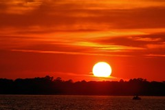 Orange Sky (Ernie E - INACTIVE) Tags: sunset orange sun boat muted ponceinlet