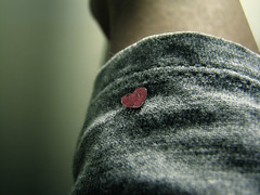 My Small Heart on a Sleeve (literally) III (Atomic Citrocity) Tags: red silver shiny heart gray reflective sleeve