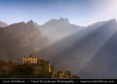 Yemen - Sun rays over Manakha in Harraz mountains ( Lucie Debelkova / www.luciedebelkova.com) Tags: old trip travel vacation panorama house mountain mountains building brick tourism nature beautiful rock wonderful landscape outdoors town fantastic scenery asia mood view mud awesome natureza country hill scenic middleeast natuur atmosphere paisaje paisagem arabic east valley arabia stunning vista remote yemen outlook middle overlook paysage exploration incredible eastern landschaft range fortress breathtaking paesaggio islamic walled beautifulscenery haraz fortified edgeoftheworld wildnerness magiclight dramaticlight jemen harazmountains harrazmountains luciedebelkova wwwluciedebelkovacom