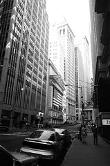 New York (Peter Gutierrez) Tags: photo united states us usa america american new york city urban car traffic road street streets black white manhattan peter gutierrez petergutierrez wall wallstreet building buildings skyscraper skyscrapers architecture canyon diamondclassphotographer sidewalk pavement public bw ny film americana photograph photography