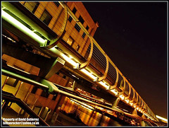 The London Millenium Bridge at Night Perspective (david gutierrez [ www.davidgutierrez.co.uk ]) Tags: city uk longexposure travel bridge urban building london architecture modern night buildings dark spectacular geotagged photography photo interestingness arquitectura cityscape darkness angle image dusk centre perspective cities cityscapes bridges millenium landmark center icon structure millenniumbridge architectural explore nighttime finepix londres architektur nights fujifilm sensational metropolis londra impressive nightfall municipality edifice cites s6500fd s6000fd fujifilmfinepixs6500fd
