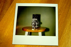 I took a picture with my Nikon of a Polaroid of my Rollei! (::cyndi::) Tags: rolleiflex polaroid nikon d100 spectra woodenstool 2008yip flickrhasthehiccupstonight