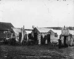 Street scene in Whitehorse, YT, 1901 (Muse McCord Museum) Tags: canada bicycle whitehorse mccordmuseum musemccord
