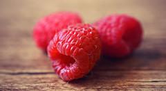 Raspberry Trio. (Through Serena's Lens) Tags: 7dwf macro closeup raspberry trio red color fruits berries tasty fresh stilllife dof