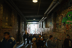Tourists swarming the Gum Wall under Pike Place Fish Market in Seattle (JasonianPhotography) Tags: people pikeplacefishmarket postalley gumwall washington tourists seattle art unitedstates us