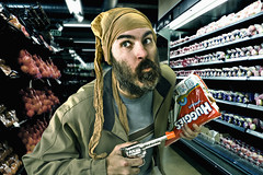 I'll just take these Huggies, and whatever cash you got ... (048/365) (wiseacre photo) Tags: portrait man face movie beard store interestingness gun run scene supermarket explore robbery diapers pantyhose day48 steal flee huggies