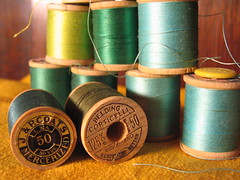 Spools of vintage thread: greens