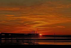 Fiery sunset (eMMa_bOOm) Tags: sunset sea sun holland beach nature lines island structures lowtide bloodred supershot platinumphoto superbmasterpiece diamondclassphotographer flickrdiamond goldstaraward goldmedalwinnergoldstaraward coppercloudsilvernsun