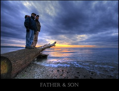 Father and son (Jerimias Quadil) Tags: sea clouds sunrise you buddy hugs miss fatherson themoulinrouge flickrsbest i golddragon impressedbeauty megashot theperfectphotographer jerimiasquadil