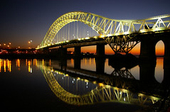 Runcorn Bridge at Twilight (25,000+ views) (Chris Beesley) Tags: road longexposure bridge sunset favorite reflection water night liverpool river dark evening interesting twilight long exposure nightshot traffic cheshire bright pentax tripod super favourite ppg reflexions mersey runcorn merseyside manchestershipcanal blueribbonwinner 10faves k100d 14000views superaplus aplusphoto superbmasterpiece diamondclassphotographer theunforgettablepictures 200850plusfaves photofaceoffwinner coolestphotographers pentaxphotogallery justpentax reflectedbridge thegoldproject