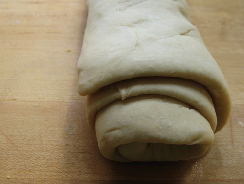 baking bread: dough rolled up