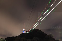 Ride to the t o p (Elios.k) Tags: horizontal outdoors nopeople cable cablecar aerialtramway longexposure lights movement sky clouds cloudyweather night tower mountain trees flare light travel travelling august 2016 summer vacation dark canon 5dmkii camera photography colour color touristic sight tourism nseoultower namsan mountnamsan ytnseoultower namsantower seoultower junggu seoul korea southkorea asia