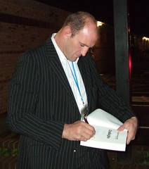 Lawrence signing his book
