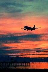 YVR with Urban Acid Action (Airchinapilot) Tags: sunset birds clouds canon airport dock shoreline landing yvr airliner 30d photoshopaction urbanacid canonef100400mmf4556lisusm