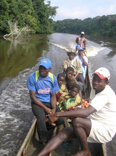 On our way down the Lomami river to Ngombe village, DRCongo, with the chief of Obenge in the cowboy hat