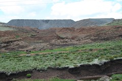 The waste rock dump from the open cast mine...