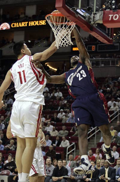 Yao Ming blocks a dunk attempt by LeBron James on Thursday night in Houston.  Yao led all Houston scorers with 22 points.  He also grabbed 12 boards in a 92-77 Houston win, their fifth in a row.