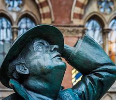 John Betjeman Statue (St Pancras Railway Station) (High ISO) Olympus OMD EM5II & M.Zuiko 12-100mm F4 Pro Zoom (1 of 1) (markdbaynham) Tags: st pancras railway station london capital city sculpture figure art bronze londonist londoner urban metropolis olympus omd em5 em5ii csc evil mirrorless mft m43 m43rd micro43 mz mzd zd mzuiko 12100mm f4 pro travelzoom highiso john betjeman