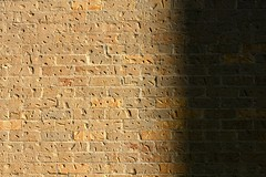 morning (xgray) Tags: morning light shadow sunlight brick texture wall contrast digital upload canon austin eos university texas bricks rental universityoftexas iphoto ef85mmf18 40d jestercenter ziplens