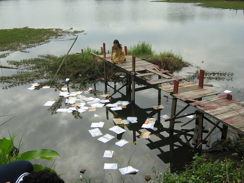 Miss Carol (Carmen Soo) picking books from the pond