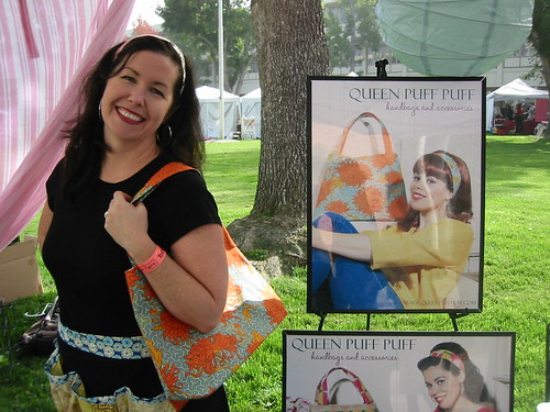 Nicole of Queen Puff Puff modeling her handbag and headband