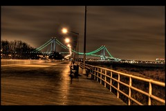 South Beach Boardwalk / Verrazano-Narrows Bridge (andy in nyc) Tags: nyc newyorkcity bridge newyork night geotagged lights tripod multipleexposure boardwalk railing statenisland southbeach hdr d300 verrazano photomatix interestingness102 i500 5xp tamron1750 explore21dec07