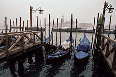 Gondolas #2 (Justin Goode) Tags: justin venice italy fog reflections nikon kodak f100 portfolio nikkor 160vc portra gondolas goode 24120mmf3556gvr justingoode wwwjustingoodephotographycom wwwgoodephotographybiz