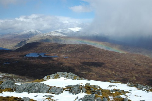 Another heavy snow shower passes with rainbow in tow