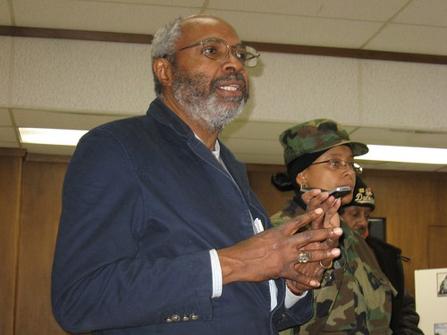 Abayomi Azikiwe, editor of the Pan-African News Wire, at a community meeting in Benton Harbor, Michigan on the plight of jailed BANCO leader Rev. Edward Pinkney. Belinda Brown of Benton Harbor holding cellphone. (Photo: Allan Pollock). by Pan-African News Wire File Photos
