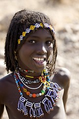 Afat Tribe Girl With Sharpened Teeth, Assaita, Afar Regional State, Ethiopia (Eric Lafforgue) Tags: africa girls portrait people haircut beauty face vertical hair photography necklace women day child african decoration culture happiness jewelry tribal innocence beautifulwoman bead braids females tradition ethiopia ornate tribe ethnic hairstyle scar beautifulpeople oneperson amulet frontview confidence traditionalculture adornment hornofafrica individuality ethnology headandshoulders ethiopian afar eastafrica toothysmile braidedhair traditionalclothing realpeople colorimage lookingatcamera statussymbol traveldestination danakil 1people pastoralist indigenousculture 89years africanculture onegirlonly mg0471 asaita assayta sharpenedteeth africantribalculture