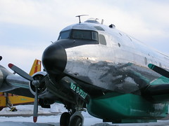 shiny bird (FlickrFlyr) Tags: old reflection plane airplane aircraft aviation c flight o2 fea dc4 buffaloairways