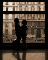 Love is patient, love is kind. (WanderWorks) Tags: door italy milan building window silhouette museum sepia children couple pair valentine embrace facetoface valentinesday dscn8638lmpc4g dscn8638c4nsepiag