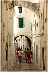 Stroll (aRfi!) Tags: trip italy white architecture tourists historical walls narrow photostream alleys paved ostuni