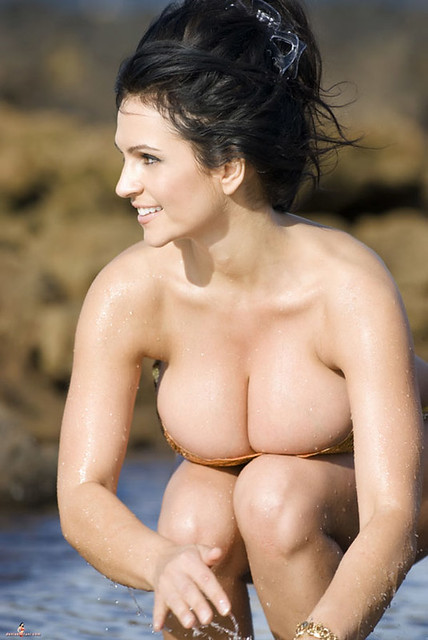 Sexy bikini babe Denise Milani posing for camera at beach