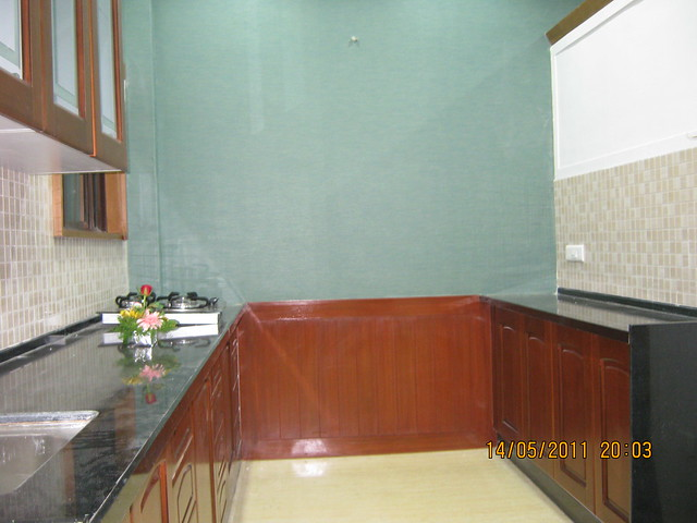 "Kitchen in a 3 BHK ""Show"" Flat in Om Developers' Tropica, Blessed Township at Ravet PCMC, Pune 412 101"