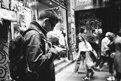 mr happy chimping (mugley) Tags: street city portrait people urban blackandwhite sunglasses photographer crowd australia melbourne victoria olympusxa2 centreplace ilfordxp2super400 ilfordxp2400super mustang1430 rdigerrambo