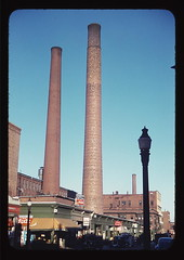 Lowell, Mass., street  (LOC) (The Library of Congress) Tags: street toxic vintage ma jack awning industrial factory streetlamp massachusetts pinkfloyd lamppost smokestack pollution libraryofcongress cocacola 1914 moxie hopper forties chimneys 1941 gaslight sunnyday delano fsa lowell industrialarchitecture schoorsteen middlesexcounty owi fsaowi fromslide jackdelano xmlns:dc=httppurlorgdcelements11 dc:identifier=httphdllocgovlocpnpfsac1a33857