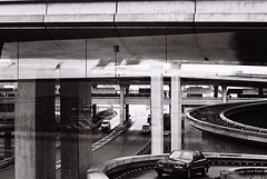 music for the airports #1 (gguillaumee) Tags: sky urban blackandwhite bw france reflection film car architecture landscape grey mercedes airport scenery view curves highways roads illford cdg 400iso nikonf80