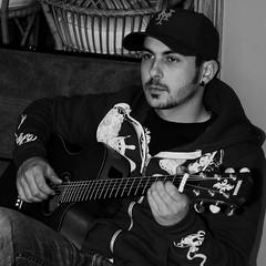 Musician (Mary Susan Smith) Tags: musician male blackwhite guitar candid cousin 3waychallengewinner photofaceoffwinner photofaceoffgoldmedal pfogold