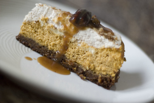 pumpkin cheesecake with pecan bourbon caramel sauce