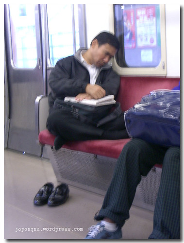 Man asleep in train